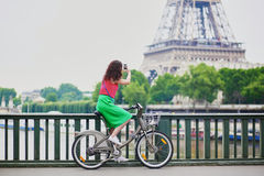 Woman riding a bicycle on a street of Paris Stock Photos