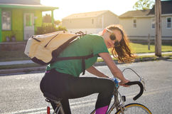 Woman riding bicycle on the street Stock Photo