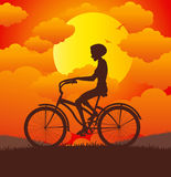 Woman riding bicycle Royalty Free Stock Photo