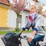 Woman riding bicycle. Stock Photography