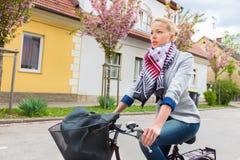 Woman riding bicycle. stock photos