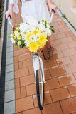 Woman riding a bicycle with flowers, detail Royalty Free Stock Photos