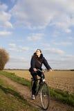 Woman riding a bike Royalty Free Stock Photos