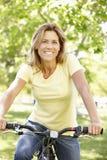 Woman riding bike Royalty Free Stock Photo