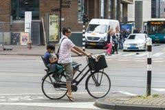 A woman riding a bike Royalty Free Stock Image