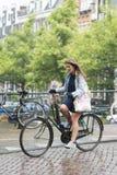A woman riding a bike Royalty Free Stock Photography