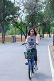 Woman riding a bike Stock Photos