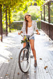 Woman riding bike Stock Photography
