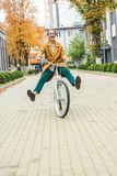 Woman riding bike stock image