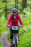Woman riding bike Royalty Free Stock Photography