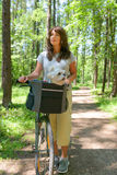 Woman riding a bike with her dog Royalty Free Stock Images