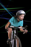 Woman riding a bike, studio shot Royalty Free Stock Photos