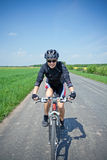 Woman riding bike on a summer day Stock Image
