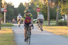 Woman riding bike on the Withlacoochee State Trail. royalty free stock images
