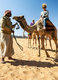 Woman riding a camel Royalty Free Stock Photography