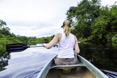 Woman riding canoe in Pantanal River, Brazil Royalty Free Stock Photos