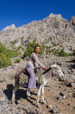 Woman riding on donkey in the mountain Stock Photography
