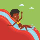 Woman riding down waterslide vector illustration. Stock Photos