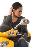 Woman riding electric scooter with no helmet Royalty Free Stock Photos