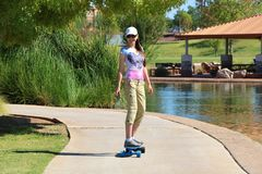 Woman Riding an Electric Skateboard Royalty Free Stock Images