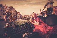 Woman riding on gondola Stock Image