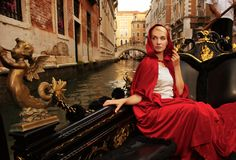 Woman riding gondola on Venice canal Stock Photography