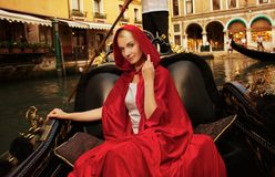 Woman riding gondola on Venice canal Stock Images
