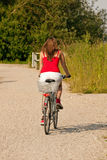 Woman riding her bicycle in summer Royalty Free Stock Photography