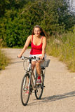 Woman riding her bicycle in summer Stock Image