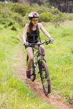 Woman riding her bike Royalty Free Stock Photo