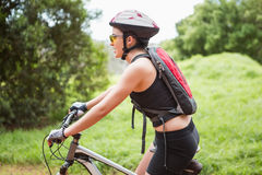 Woman riding her bike Royalty Free Stock Image