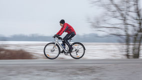 Woman riding her bike. Panning. Klimovsk, Moscow Region, Russia - April 4th, 2015: Moscow cycling club Caravan event - 200km brevet(randonneuring, audax). Woman Royalty Free Stock Photo