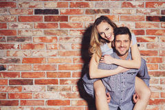 Woman riding on her boyfriend`s back Stock Images