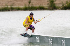 Woman riding her wakeboard Royalty Free Stock Image