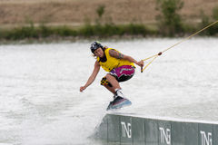 Woman riding her wakeboard. ISLE-JOURDAIN, FRANCE - MAY 27, 2011: woman wakeboarding at the International Wake'n Country on may 27, 2011, , Isle-Jourdain, France stock image