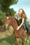 Woman riding horse Royalty Free Stock Images