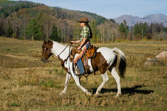 Woman Riding Horse Stock Image