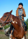 A woman riding a horse. In sport Royalty Free Stock Images