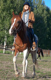 A woman riding a horse Royalty Free Stock Photo