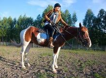 A woman riding a horse Stock Photography
