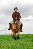Woman riding horse royalty free stock photography