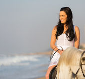 Woman riding horse beach Stock Photos
