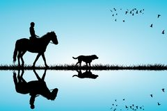 Woman riding a horse and dog. Silhouettes Stock Photos