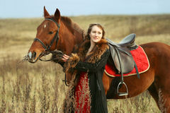 Woman riding horse in the field Stock Images