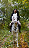 Woman riding a horse in the forest Stock Photography