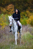 Woman riding a horse in the forest Royalty Free Stock Image
