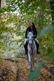 Woman riding a horse in the forest Royalty Free Stock Photos