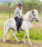 Woman riding a horse Royalty Free Stock Photo