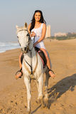 Woman riding horse Stock Photos
