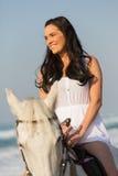 Woman riding horse. Smiling young woman riding a horse on beach Stock Photos
